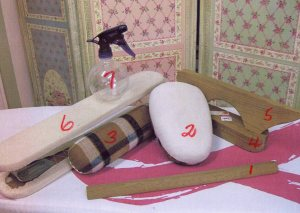 1: Seam stick and organza press cloth 2: Tailor's ham 3: Seam roll 4: Clapper 5: Point presser 6: Sleeve board 7: Spray bottle