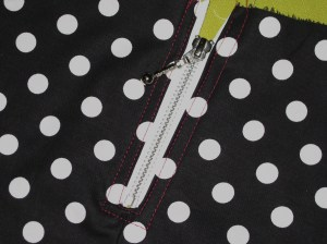 Centre zip against wrong side and stitch in place.