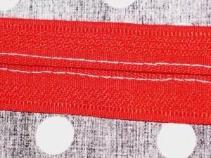 Underside of zipper.