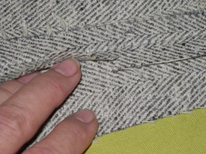 Top seam allowance pressed flat after being stretched. Bottom seam allowance clipped.