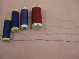 Threads arranged according to thickness - finest to heaviest. From left: Gutermann polyester topstitching Gutermann polyester all purpose Metrosene poly sheen embroidery Metrosene polyester all purpose