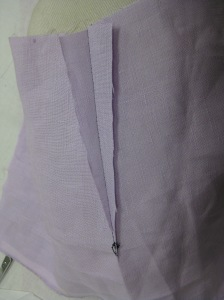 Dart slashed and pressed open will give a flatter garment surface in lined garment.