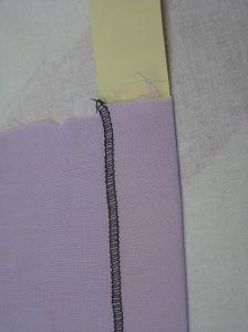 Using a manilla strip cut to the hem depth makes pressing an even hem allowance very easy.