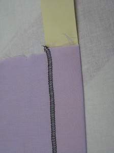 Using a manilla strip cut to the hem depth makes pressing an even hem allowance very easy.