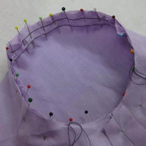 Pinned right on seam line from inside the sleeve.