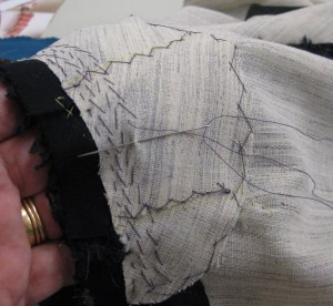 Back neckline support piece held over my hand to build in curved shape with small pad-stitches.
