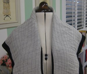 Remaining collar section has been loosely pad-stitched.