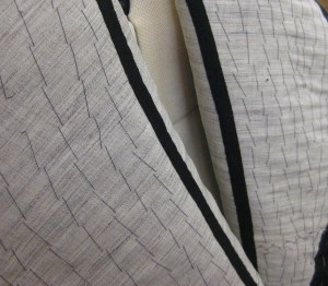 Taped roll line will keep lapels in place.