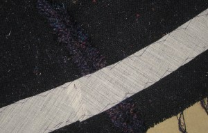 Hair canvass catch-stitched in the hem area of the jacket and sleeves.