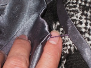 Hem finished with Hong Kong binding; French tack secures lining and top of hem