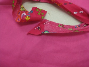 Start by folding leading end of trim at right angles to cut edge and start stitching