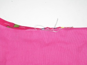 Hand stitch from just under the fold to the seam stitching