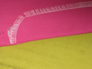 Press fly to wrong side and understitch above marked point for bottom of zipper.