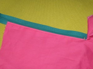 Place right side of zipper against underlap fold - keep teeth close to zipper.