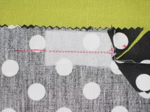 Stitch to close seam below zipper opening.