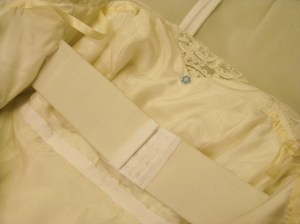 Elastic stay and Petersham waist stay are lie inside the gown - over the silk lining (inserted by hand).