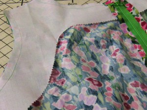 Sew in interfacing tacked in place to support neckline and armholes.