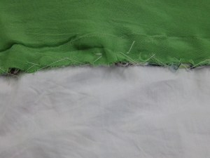 Seam allowances of lining and garment between bodice and underlay stitched together
