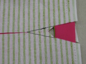 Turn buttonhole fabric to wrong side along base.