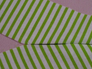 Fold buttonhole fabric so that it meets in centre of the hole.