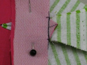Fold back the base and machine stitch just inside the original stitching.