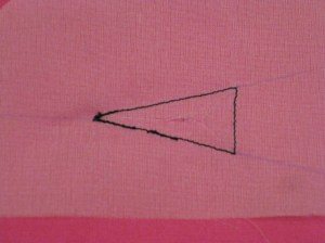 Mark the triangular opening on the wrong side of the garment.