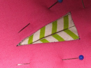 Position faced hole in facing over the underside of the buttonhole and handstitch in place.