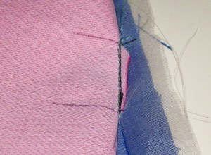 Fold garment back and stitch just inside former stitching lines.