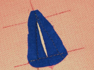 Remove tacking stitches and trim the shape.