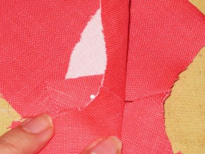 Pin through facing seam allowance and then through garment seam allowance to ensure seam lines are aligned.
