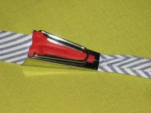 Feed fabric strip into bias maker. Press folded edges as you slowly slide the bias maker along the strip.