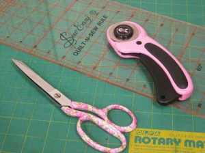 Dressmaking shears with rotary cutter, mat and ruler.