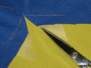 Use small very sharp scissors to clip through both fabric layers to the pivot point.