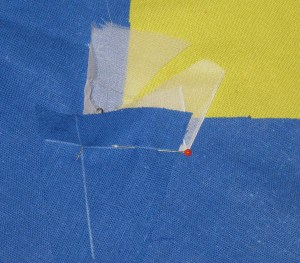 Position fabric pieces with right sides together and the pivot point and seam lines aligned.
