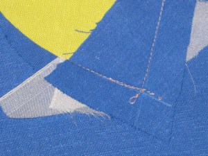Stitch through the point on one side - keeping the stay stitching in view.