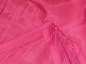 Seam allowances pressed open at side seams and away from armhole seam in underarm area.
