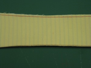 To maintain correct placement when collar is attached to stand, place two bottom edges exactly together and stitch within seam allowance.