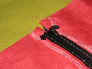 Stitch ends of tapes to seam allowances so they will not flap up.