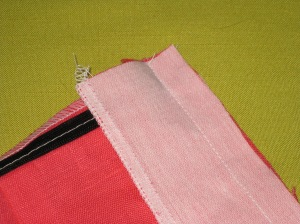Facing stitched to the edge - zipper tapes are not caught in the seam.