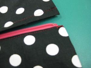 Thread bar on underside; hook on upper side.