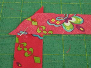 Place bias strips at right angles and stitch across the angle.