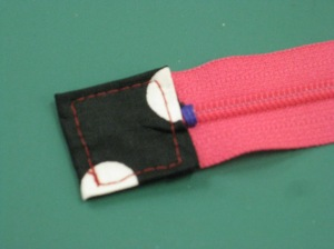 Shorten zipper to desired length; cut excess and cover