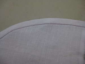 Narrow curved hem which has been machine stitched