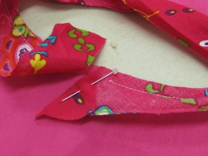 Fold binding at right angle and commence stitching over the fold.