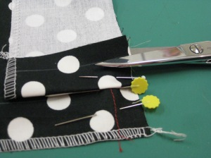 Fold seam allowance back over the facing and pin in place