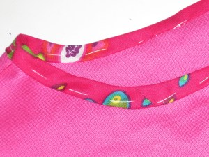 Turn binding at right angles to the seam line. Tack in place so it does not move or ripple.