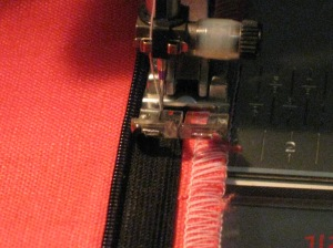 Position sewing foot against the teeth and machine baste in place.