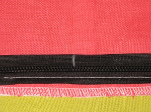 Mark unsewn zipper tape where the seam line sits.