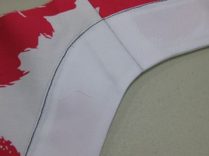 Facing is turned to right side and edge stitched in place. This is an alternative to a separate band. Seam allowance is invisible from underside of neck edge.