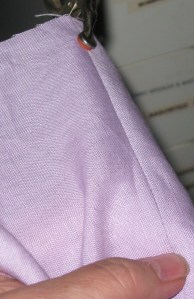 Clamp fabric and pull the seam to be unpicked until it is taut